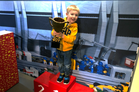 Gabe holding a Lego cup at the Brick Science event at Rheged