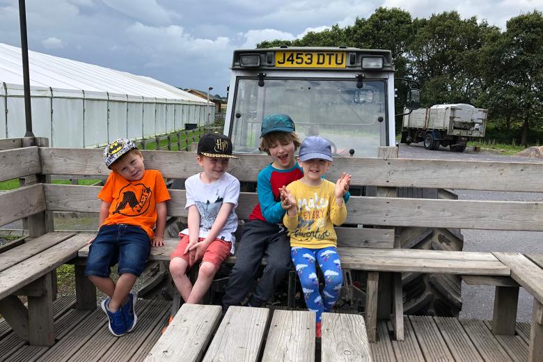 Boys enjoying a tractor ride at Apple Jacks Adventure Farm