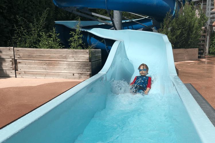 Toby on  a waterslide