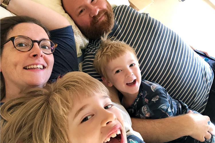Family bed selfie