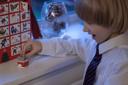 Toby building the Lego from his advent calendar