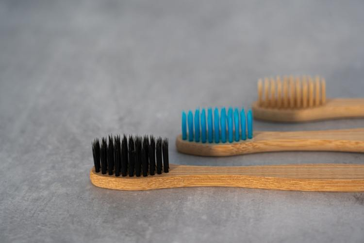 Three bamboo toothbrushes - Looking after your teeth can help beat the ageing process