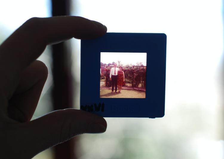 silhouette of a hand holding an old slide
