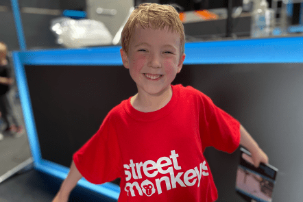 Gabe showing off his new red Street Monkeys t-shirt