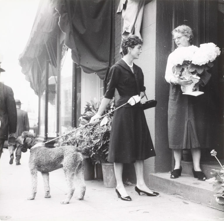 Jackie Kennedy walks the couples' dog around Georgetown in 1954.