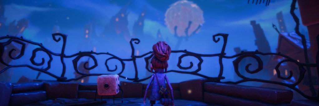 Par y Dadelio frente a una valla y de fondo una ciudad y una luna