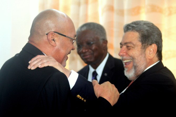 Prime Minister Ralph Gonsalves of St. Vincent and the Grenadines (right)  in good spirits with President Desi Bouterse of Suriname (left) and Prime Minister Freundel Stuart of Barbados