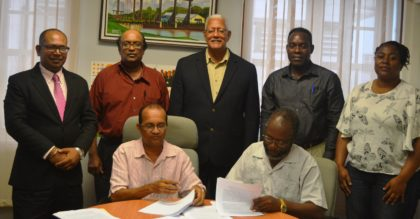 Officials at the signing ceremony. Centre, standing, is Minister of Agriculture of Guyana, the Hon. Noel Holder