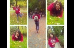 Student in Chico State sweatshirt poses around campus with fall leaves