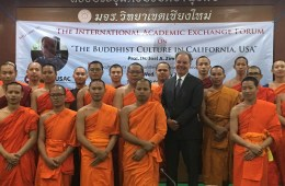 Chico State professor Joel Zimbleman stands with a group of monks during his time teaching overseas.