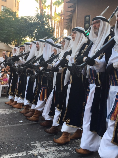 Participants in an annual historical re-enactment stroll down the streets of Alicante, Spain.