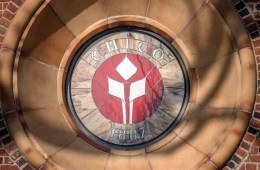 The flame logo emblem is seen in stain glass on Kendall Hall
