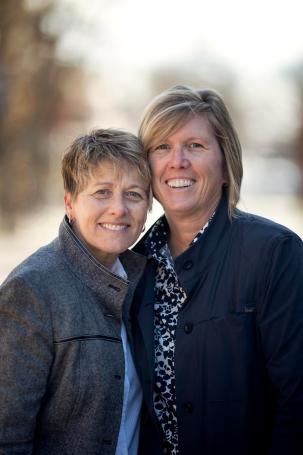 Mary Wallmark and Kim Chappell stand cheek to cheek.