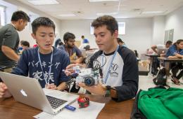 Ler Lor (left) and Adrian Vera (right) work on lego robotics as part of Upward Bound that focused on math, science, engineering and information technology (STEM) program on Wednesday, July 15, 2015 in Chico, Calif. (Jason Halley/University Photographer)