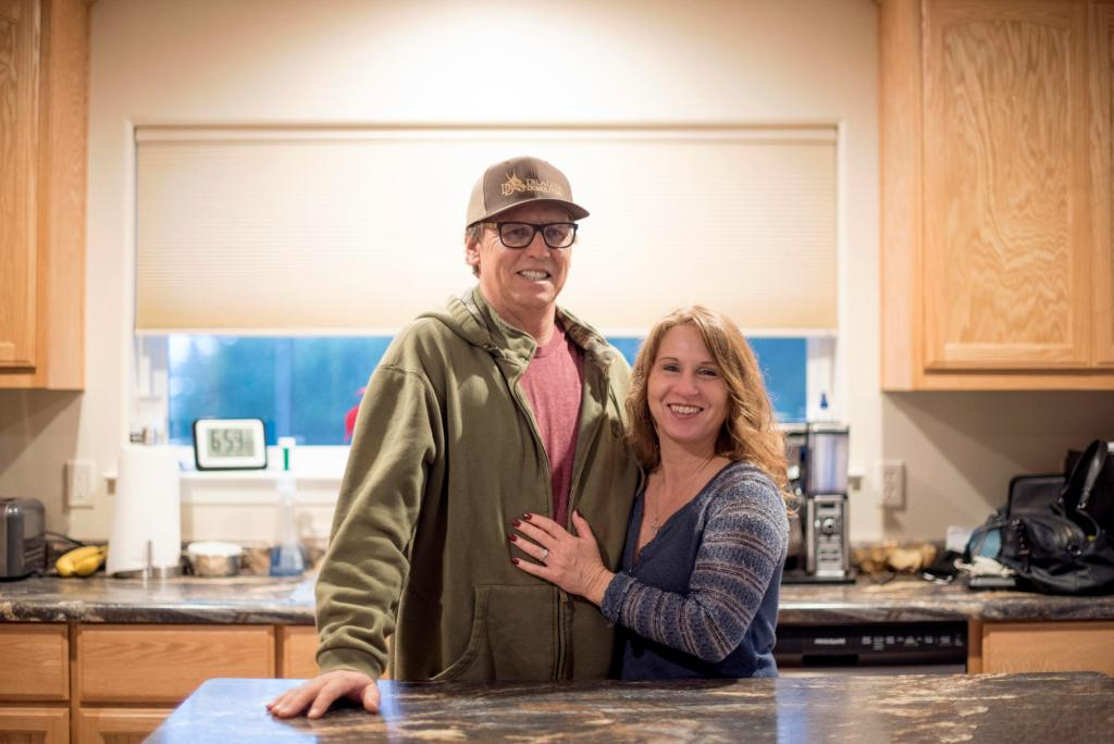 Kelly Shields and his wife, Sandy, stand in front of an island in the studio apartment they are living in while they wait to rebuild their Paradise home.
