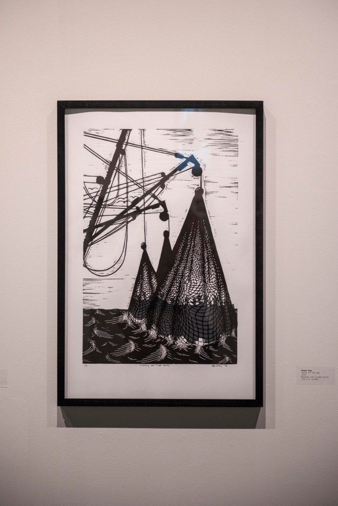A screen print depicting fishing nets in the ocean.