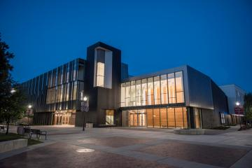 Night falls on the Arts & Humanities Building.