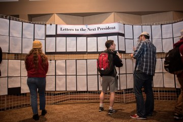 Students look at and discuss Letters to the Next President, a project by First-Year Experience, at Wildcats Vote last month (Jessica Bartlett/Chico State student photographer)