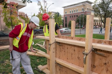 Grant Morgan (left) and Matt Hall (right) build concrete forms as part of a competition that was timed and measured for quality during a demonstration for more than 1,500 prospective students and their families visit the campus and engage directly with faculty, staff and current students at the 20th annual Chico Preview Day Saturday, October 25, 2014 in Chico, Calif. (Jason Halley/University Photographer)