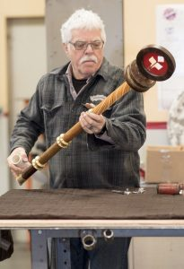 Jeff Lindsay at Red Hot Metal assembles the new mace just in time for President Hutchinson's inauguration.