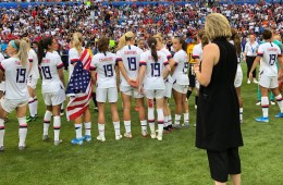 Molly Downtain stands on the field during the Wold Cup celebration.