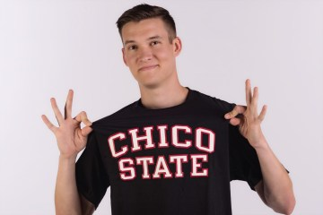 Student shows off his Chico State t-shirt.
