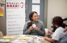 Peer Educator Janieil Harris talks with a fellow student at the Campus Alcohol and Drug Education Center.
