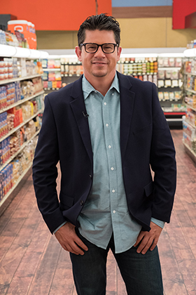 Troy Johnson poses in a grocery store aisle