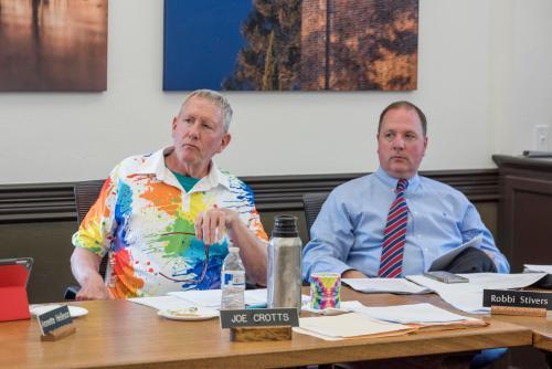 Joe Crotts (left), Robbi Stivers (VPBF) (right) and campus leadership discuss topics during an Academic Senate meeting.