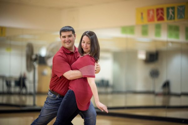Chris and Jessie Mendoza ballroom pose in a dancing hold