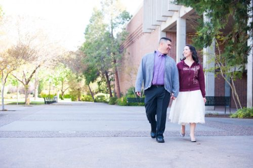 Chris and Jessie Mendoza on their wedding day holding hands, walking on the Chico State campus.