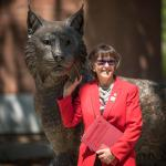 President Gayle Hutchinson poses with the new statue.