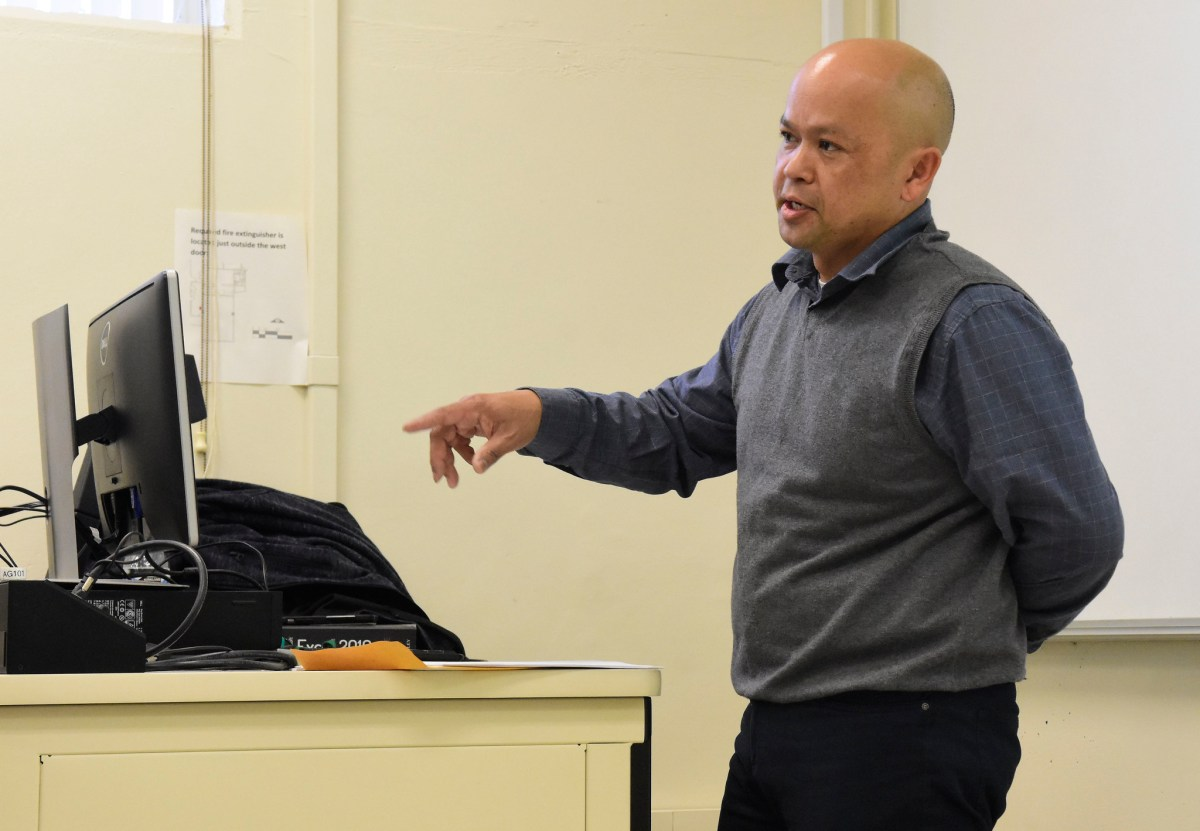 Neil motions with his hand while he lectures to a class at Fresno State.
