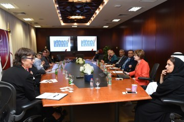 President Gayle Hutchinson along with other Chico State faculty sit with those from the UAE around a conference table.
