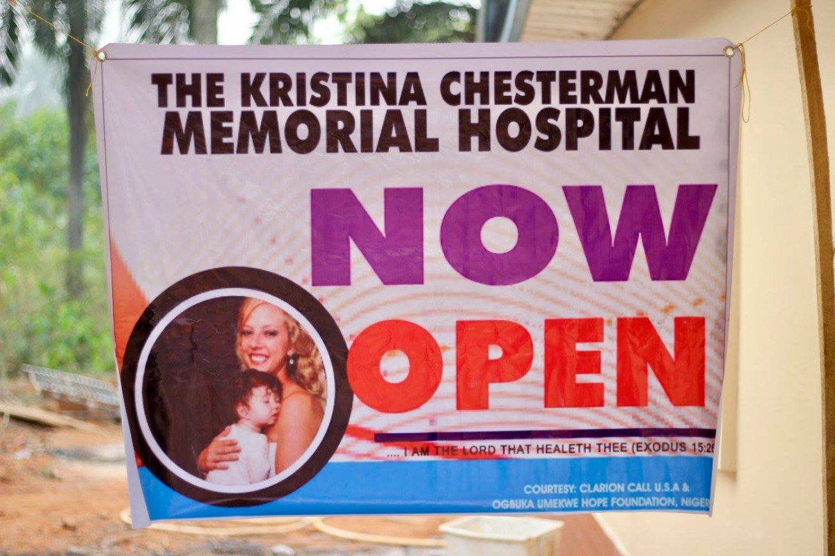 A sign advertising the clinic is open hangs on a window.