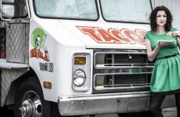Rachel Belle leans on a taco truck