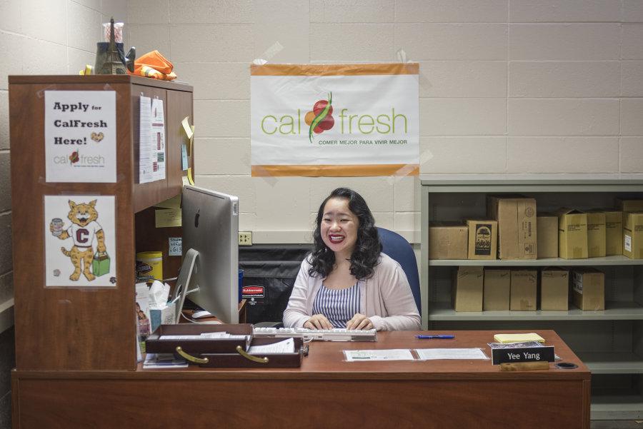 Yee Yang sits at the greeting desk at the pantry.