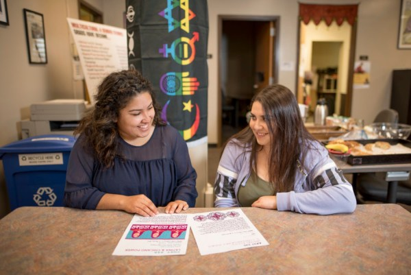 Outstanding Senior Unique Torres (left) is photographed while working with her friend Roxanna Necoechea (right) in the Center for Multicultural and Gender Studies on Thursday, April 12, 2018 in Chico, Calif.  (Jessica Bartlett /University Photographer/CSU Chico)
