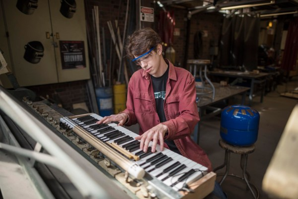 Daniel Michelson works on his DIY musical instrument creations in the Ayres Art Shop.