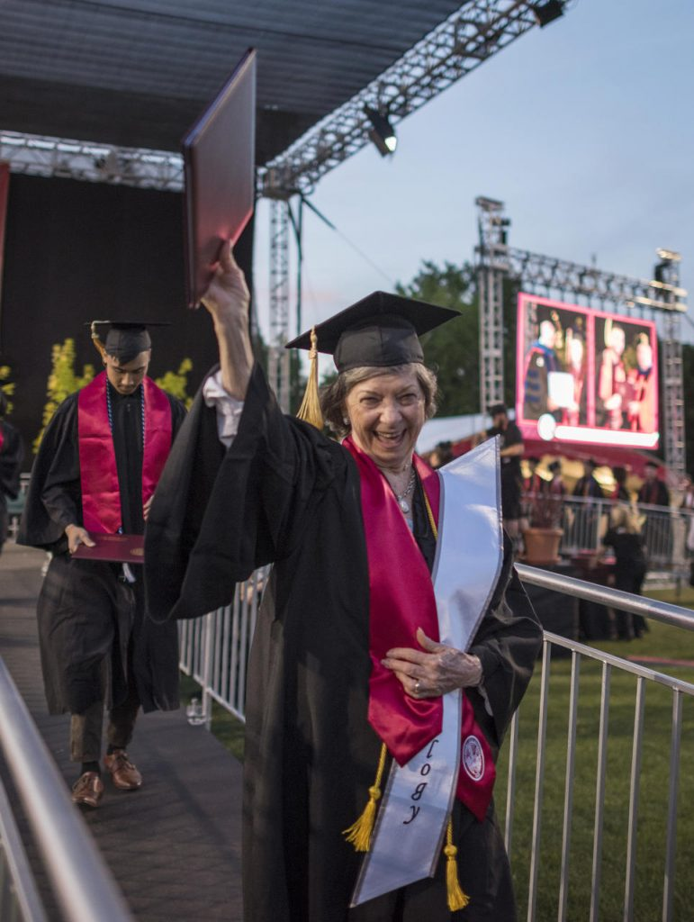 Sylvia Hamilton holds up her diploma cover after crossing the stage at Commencement.
