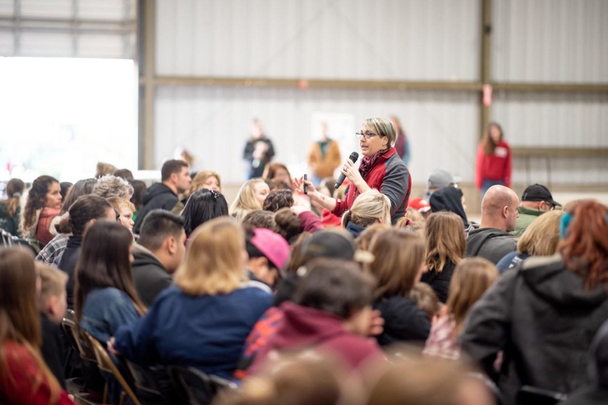 Celina Phillips talks to a crowd in the University Farm Pavilion.