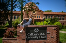 Lilah Nielsen poses on top of the California State University, Chico sign.