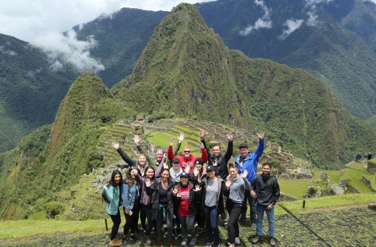 Students pose at the top of Macchu Picchu.