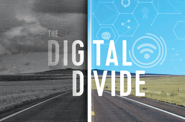 """The words """"the digital divide"""" are overlaid over a rural road, split in half, with one side looking like a cracking old black and white photo and the other side in color with internet symbols."""