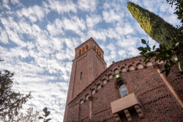 Puffy clouds float gracefully over Trinity Tower on the Chico State campus.