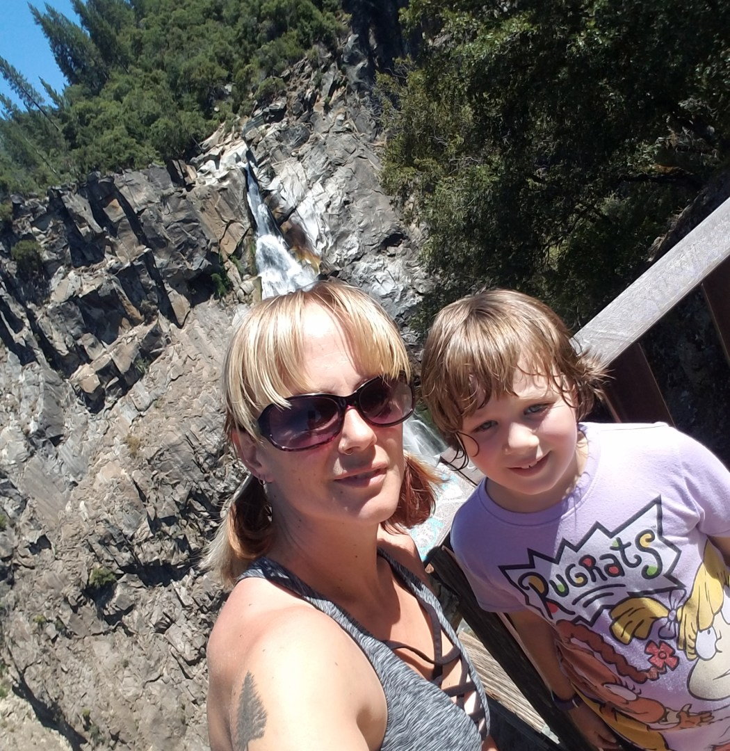 Sabrina Hanes and her daughter, Aroara, stand at the viewing platform with Feather Falls behind them.