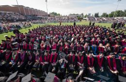 Hundreds of Chico State graduates sit and wait as Commencement ceremonies prepare to get underway.