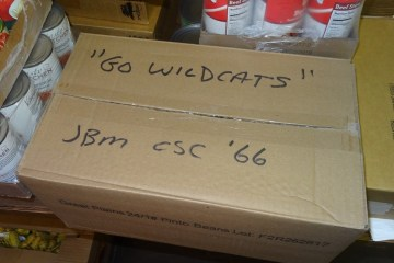 A box signed by Jim Morris sits in the Hungry Wildcat Food Pantry.