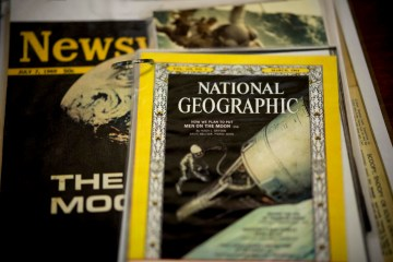 A stack of national publications report the significance of the Apollo 11 mission to the moon in 1969.