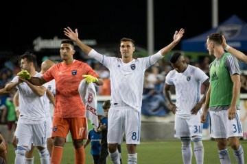 San Jose Earthquakes forward Chris Wondolowski celebrates his team's win after the game.
